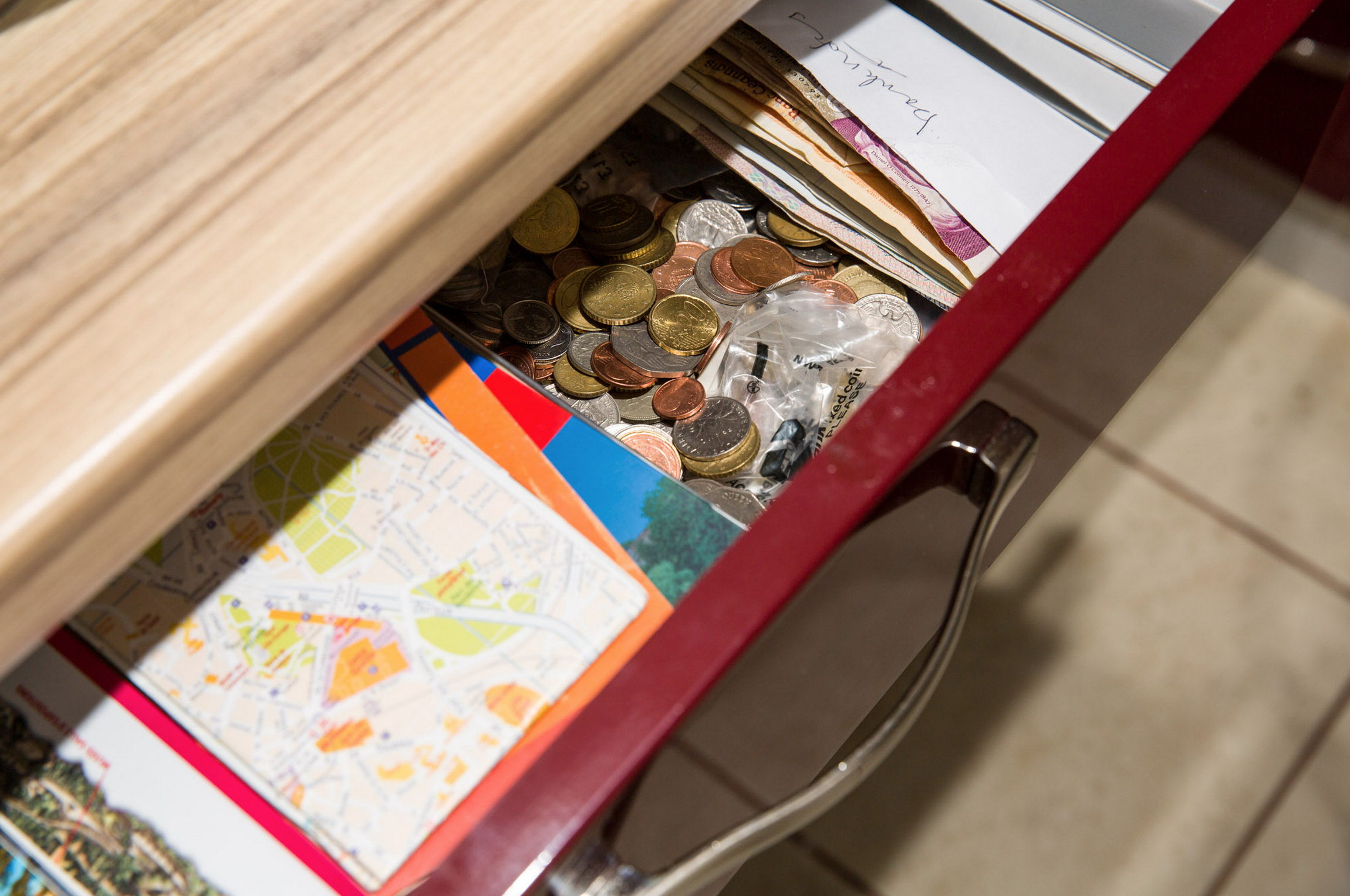 Leftover coins and notes in a drawer