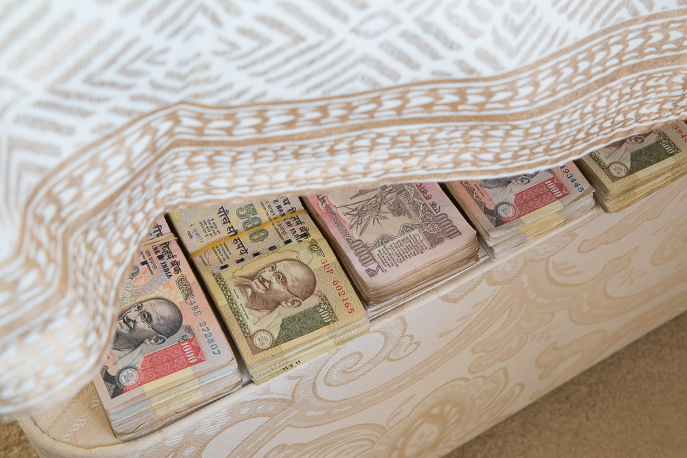 Indian rupee banknotes under the mattress