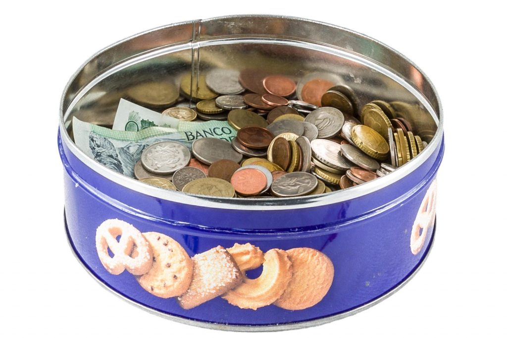 old currency in a cookie jar